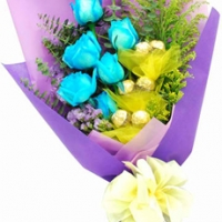 - 6 blue Roses and 6 Ferrero Rocher