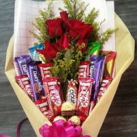 6 red roses ,12 assorted chocolates & 3 ferrero Lover basket